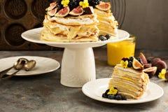 Mango and lemon curd crepe cake. With whipped cream royalty free stock photo