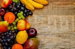 Mango, lemon, plum, grape, pear, orange, Apple, banana, avocado Stock Image