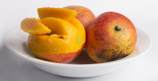 Mango with lobules. On a white background royalty free stock image