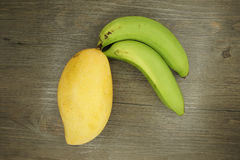 Mango or Mangifera indica banana on wood Stock Image