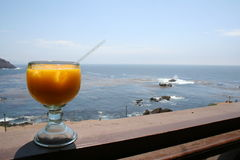 Mango Mararita. Schoomner of margarita sitting on a bar with the ocean in the background Royalty Free Stock Photos