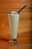 Mango milkshake drink. On wooden board Stock Photo