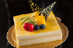 Mango Mousse Cake. Collocation of fruit and chocolate Royalty Free Stock Images
