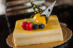 Mango Mousse Cake. Collocation of fruit and chocolate Royalty Free Stock Photography