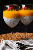 Mango mousse with chia seeds and coconut milk. An elegant table setting with homemade mango mousse with chia seeds, coconut milk, natural yoghurt, maple syrup Stock Photography