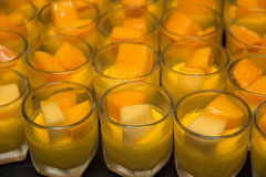 Mango mousse in a mini glass. Stock Photo