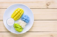 Mango and natural colored sticky rice with coconut milk Royalty Free Stock Photography