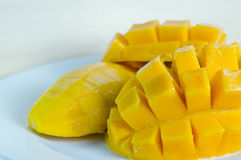 Mango nicely cut on wooden background (Also known as horse mango Royalty Free Stock Images
