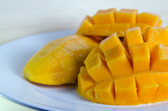 Mango nicely sliced on white plate Royalty Free Stock Photo