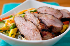 Mango noodle salad, pork tenderloin Stock Photo