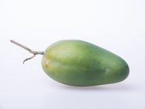 Mango o mango verde en un fondo Fotografía de archivo libre de regalías