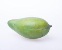 Mango o mango verde en un fondo Imágenes de archivo libres de regalías