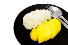Mango- och kokosnötRices. Arkivbild