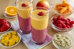 Mango Orange Raspberry Strawberry Smoothies Royalty Free Stock Photography