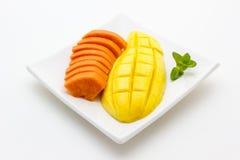 Mango and papaya on white background Royalty Free Stock Image