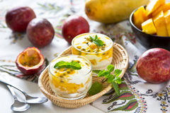 Mango and Passion fruit dessert. In glasses with mint on top Stock Image
