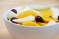 Mango Pear Salad. In a White Bowl Royalty Free Stock Image