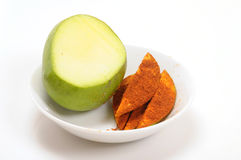 Mango pickle. On white plate Stock Photography