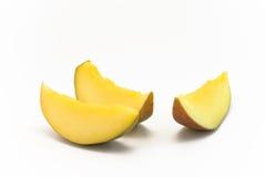 Mango pieces. Three mango slices lying togethoer on white background Royalty Free Stock Image