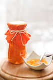 Mango and pineapple jam. In a transparent jar Royalty Free Stock Photography