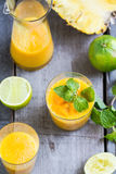 Mango with Pineapple smoothie. Fresh Mango with Pineapple and Lime smoothie Stock Photos