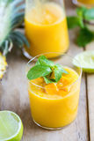 Mango with Pineapple smoothie. Fresh Mango with Pineapple and Lime smoothie Royalty Free Stock Image