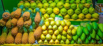 Mango, pineapple and tropical fruits are sold at the counter. royalty free stock images