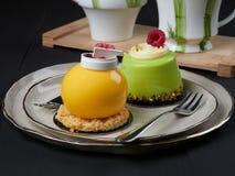 Mango and pistachio cakes stock photo