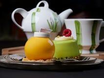 Mango and pistachio cakes royalty free stock photography