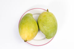 Mango on a plate having pink rim Stock Images