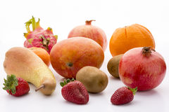 Mango, pomegranate, pitaya, orange, pear, kiwi and. Exotic and domestic fruits: mango, two pomegranates, one pitaya, two kiwifruits, a pear, three garden Royalty Free Stock Photography
