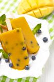 Mango Popsicles Ice Cream with Blueberry Stock Images
