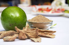 Mango powder. Amchoor or aamchur, also referred to as mango powder, is a fruity spice powder made from dried unripe green mangoes and is used as a citrusy Royalty Free Stock Images