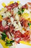 Mango prosciutto and Parmesan Stock Image