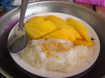 Mango rice. This is famous delicious local food of Thailand.Put some especial sauce(cook by coconut milk and milk) on the cooked sticky rice,and with some fresh Stock Image