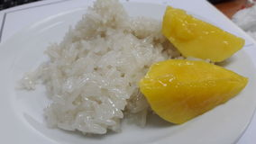 Mango and rice. Sweet mango rice . Yummy stock photos
