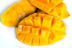 Mango ripe with nicely cut pieces isolated on white Royalty Free Stock Images