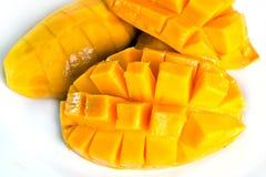 Mango ripe with nicely cut pieces isolated on white. Mango nicely cut isolated on white (Also known as horse mango, Mangifera foetida, Anacardiaceae, Mangifera Royalty Free Stock Images