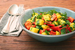 Mango salad with pepper and parsley in a bowl Royalty Free Stock Photos