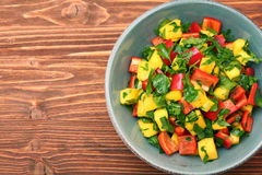 Mango salad with pepper and parsley in a bowl Royalty Free Stock Photo