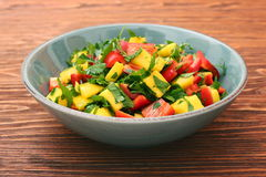 Mango salad with pepper and parsley in a bowl Stock Photos