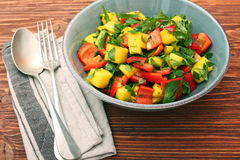Mango salad with pepper and parsley in a bowl Stock Images