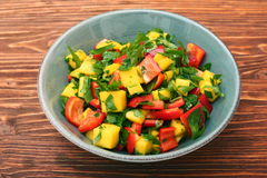 Mango salad with pepper and parsley in a bowl Royalty Free Stock Photography