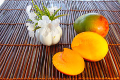 Mango. With section and white flowers Royalty Free Stock Photo