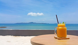 Mango shake with bright sky and sea background Royalty Free Stock Images