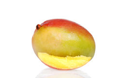 Mango with a slice Royalty Free Stock Photography