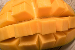 Mango slice cut to cubes close-up. Royalty Free Stock Photo