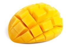 Mango slice cut to cubes isolated. On white background royalty free stock photos