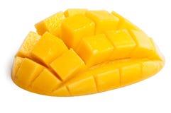 Mango slice cut to cubes isolated. On white background royalty free stock photo