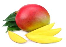 Mango slice with green leaves isolated on white background. healthy food. stock images